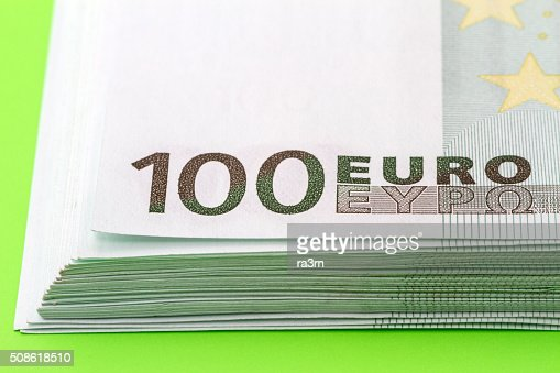 Stack of 100 euro banknotes closeup : Stock Photo