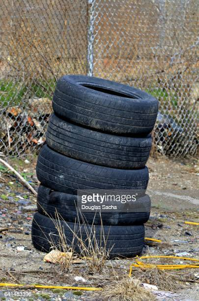 Stack of abandoned tires on a inner city sidewalk