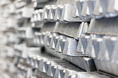 Stack of Aluminum ingots. Shallow depth of field.