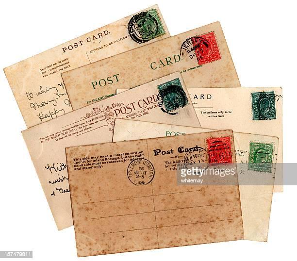 Stack of antiqued Edwardian postcards.