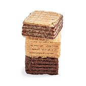 Stack of assorted square wafer biscuits isolated on white backdrop. closeup view