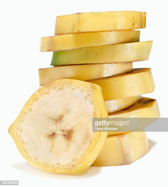 Stack of banana slices with peel on for easy snack