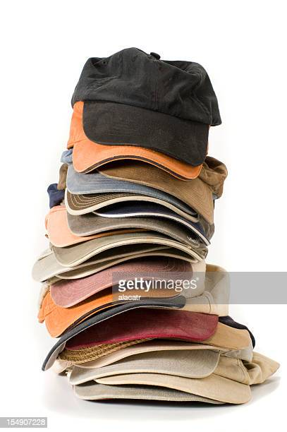 Stack of baseball caps in various colors