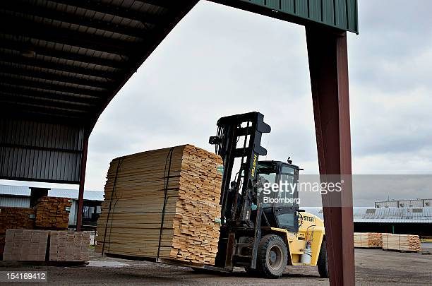 A stack of bass wood lumber is moved with a forklift after it is prepared for overseas shipment at the Nicolet Hardwoods Corp lumber mill in Laona...