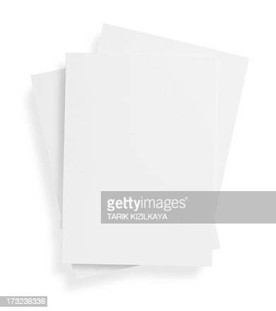 Stack of blank, white magazine covers over white background