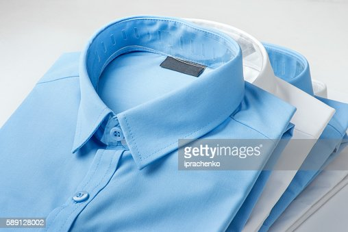 Stack of blue and white shirt : Stock Photo