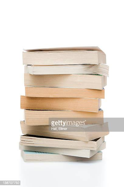Stack of books against white background, close-up