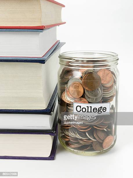 Stack of books and jar of money