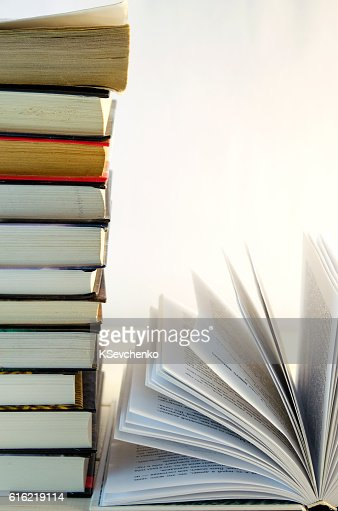 stack of books and opened book : Stockfoto