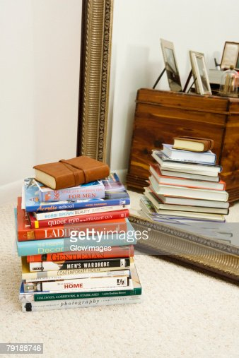 Stack of books in front of a mirror : Stock Photo