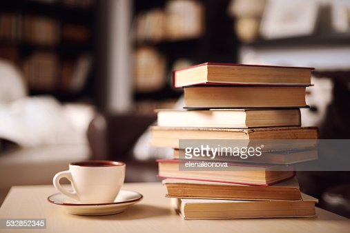 stack of books in home interior : Stock Photo
