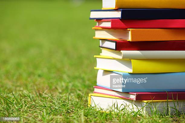Stack of Books on Grass