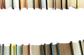 A stack of books on white background. Copy space for your text. Ideas for business and self-development. Study background