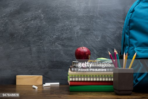 Stack of books, stationery and education supplies on wooden desk : Stock Photo