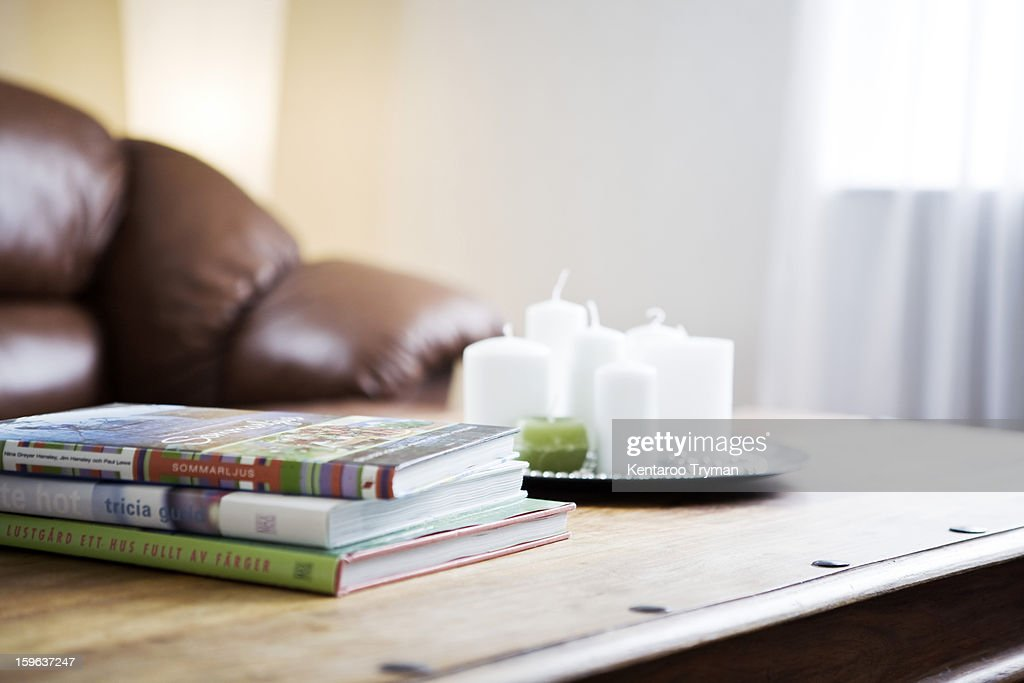 Stack of books with a tray of candles on table