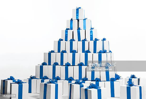 Stack of boxes in blue ribbon shaped into pyramid