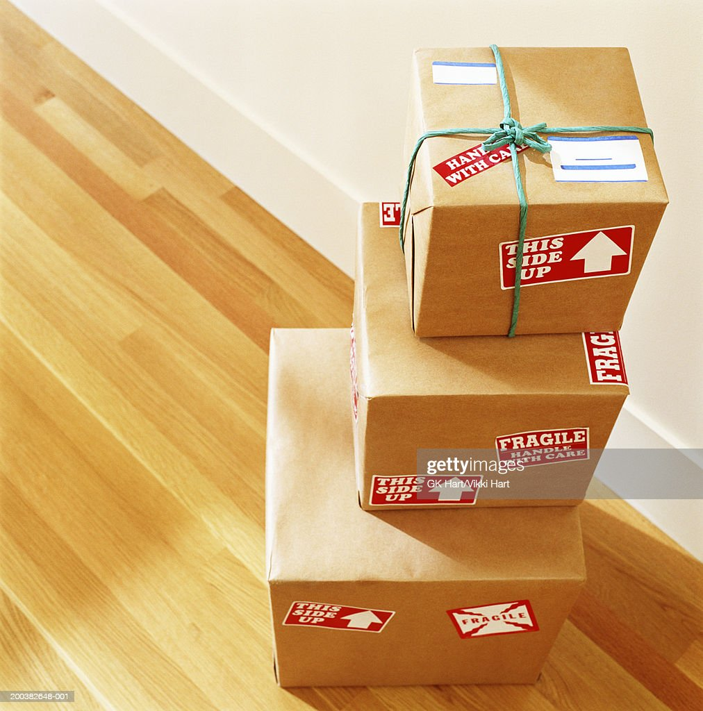 Stack of boxes labelled 'Fragile - Handle With Care', elevated view : Foto de stock