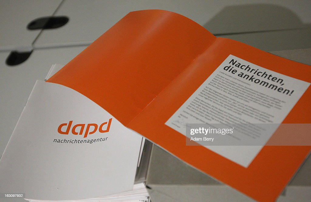 A stack of brochures about the German news agency dapd lies on a table in the company's offices on March 4, 2013 in Berlin, Germany. The country's second-largest news agency, dapd, was forced to declare insolvency for the second time in five months on March 1.