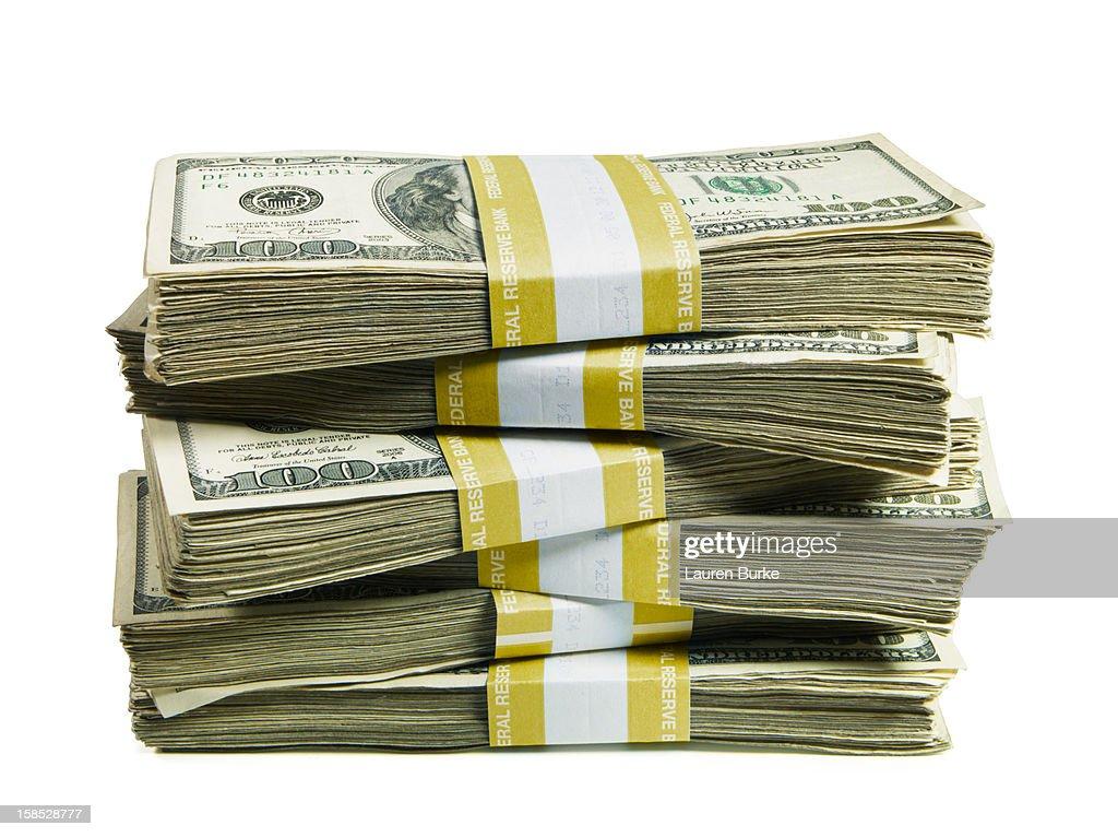 A stack of bundled hundred US dollar bills