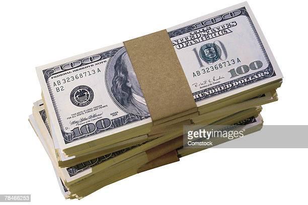 Stack of bundles of hundred dollar bills