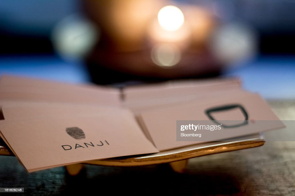 A stack of business cards for Danji restaurant sit in the front window of Hanjan Korean restaurant in New York, U.S, on Monday, Feb. 11, 2013. Hooni Kim, Korean chef and restaurateur, owns two Korean restaurants in New York, Hanjan and Michelin-starred Danji, his first restaurant. Photographer: Philip Lewis/Bloomberg via Getty Images