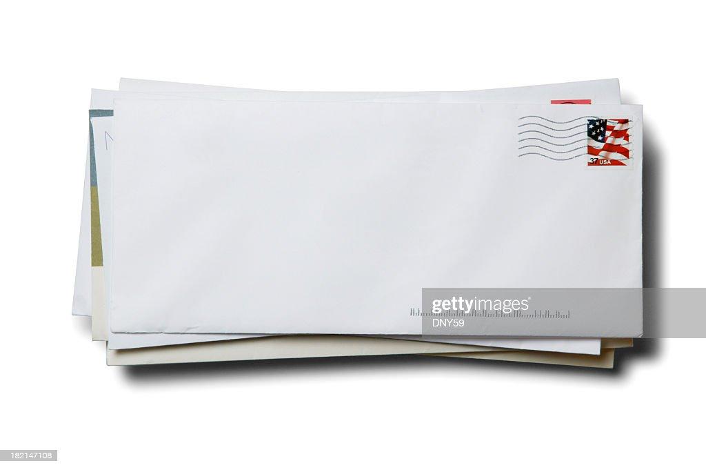 Pila di buste con timbro annullato affari su sfondo bianco : Foto stock