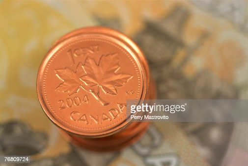 Stack of Canadian pennies on a bank note
