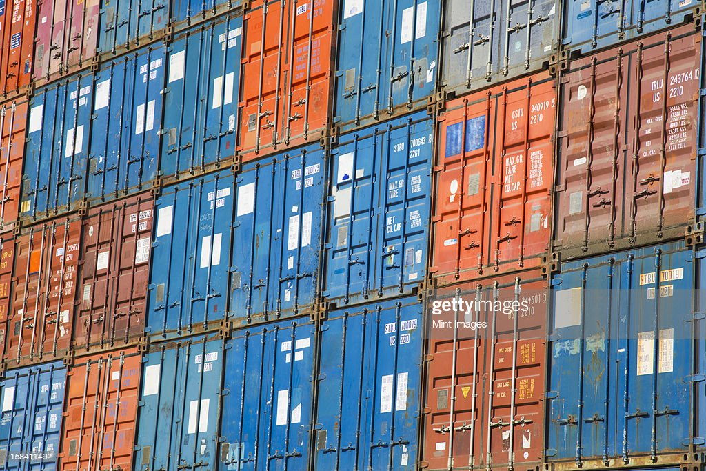 A stack of cargo containers, commercial freight containers, packed together and waiting to be moved.  : Stock Photo