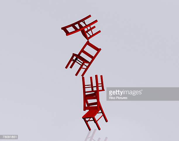 Stack of chairs falling over