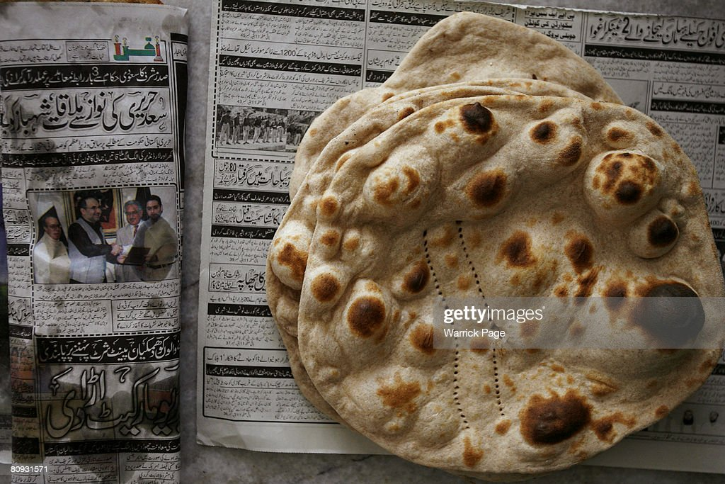 A stack of chapati lies on an Urdu newspaper at a local bakery on April 30 in Islamabad Pakistan Pakistan is experiencing a major shortage of wheat...