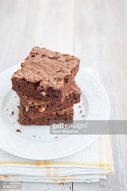 Stack of chocolate brownies with nuts