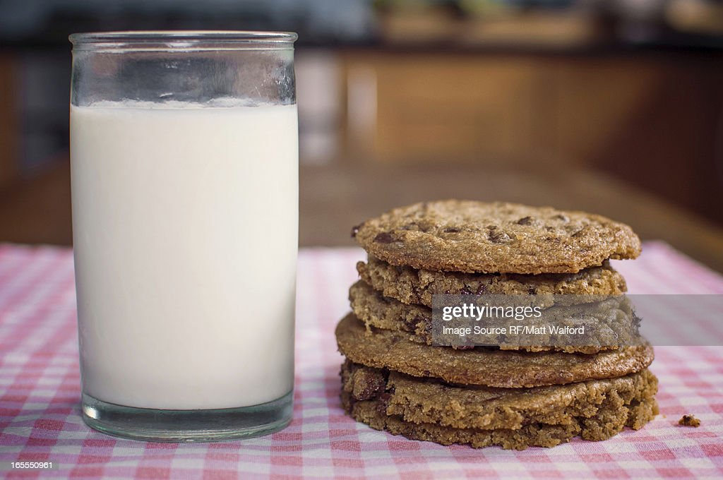 Stack of chocolate chip cookies and milk : Stock Photo