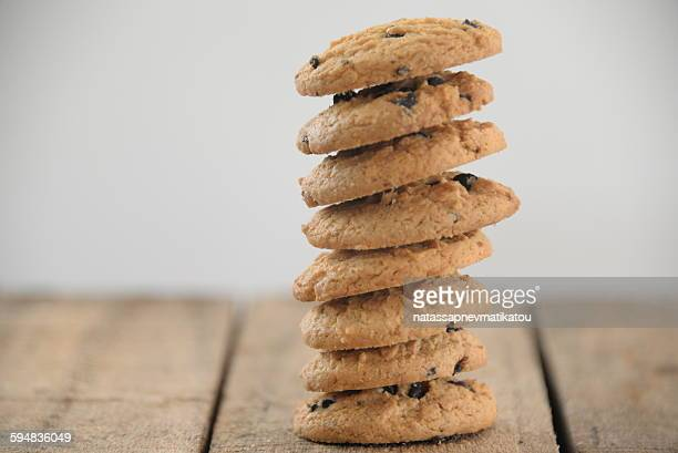 Stack of chocolate chip cookies on wooden table