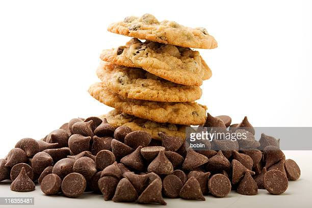 Stack of chocolate chip cookies with chocolate chips