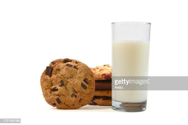 Stack of Chocolate Chip Cookies with Milk Isolated on White