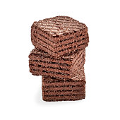 Stack of chocolate square brownie wafer biscuits isolated on white backdrop. closeup view