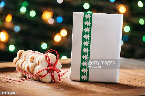 Stack of Christmas cookies and wrapped Christmas present