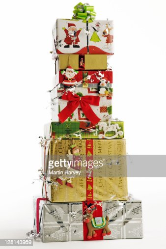 Stack of Christmas gifts against white background. : Foto de stock