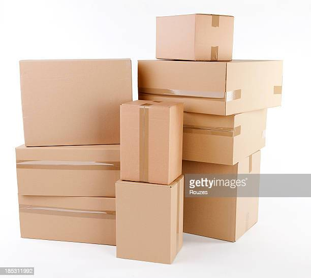 Stack of closed cardboard boxes on white background