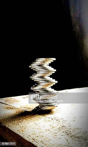 Stack Of Coins Arranged On Table
