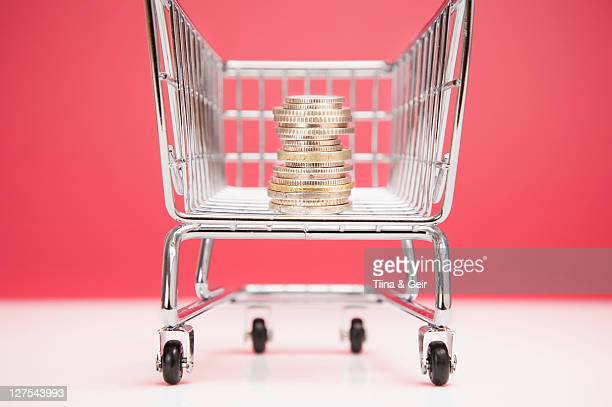 Stack of coins in shopping cart