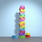 A stack of colored cardboard boxes