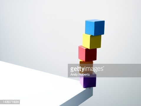 Stack of colorful cubes on table corner : Stock Photo