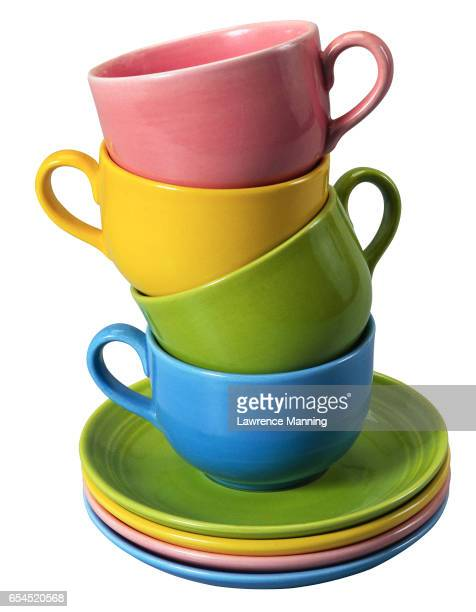 Stack of Colorful Mugs and Saucers