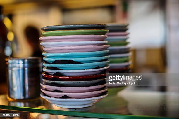 Stack Of Colorful Plates In Restaurant