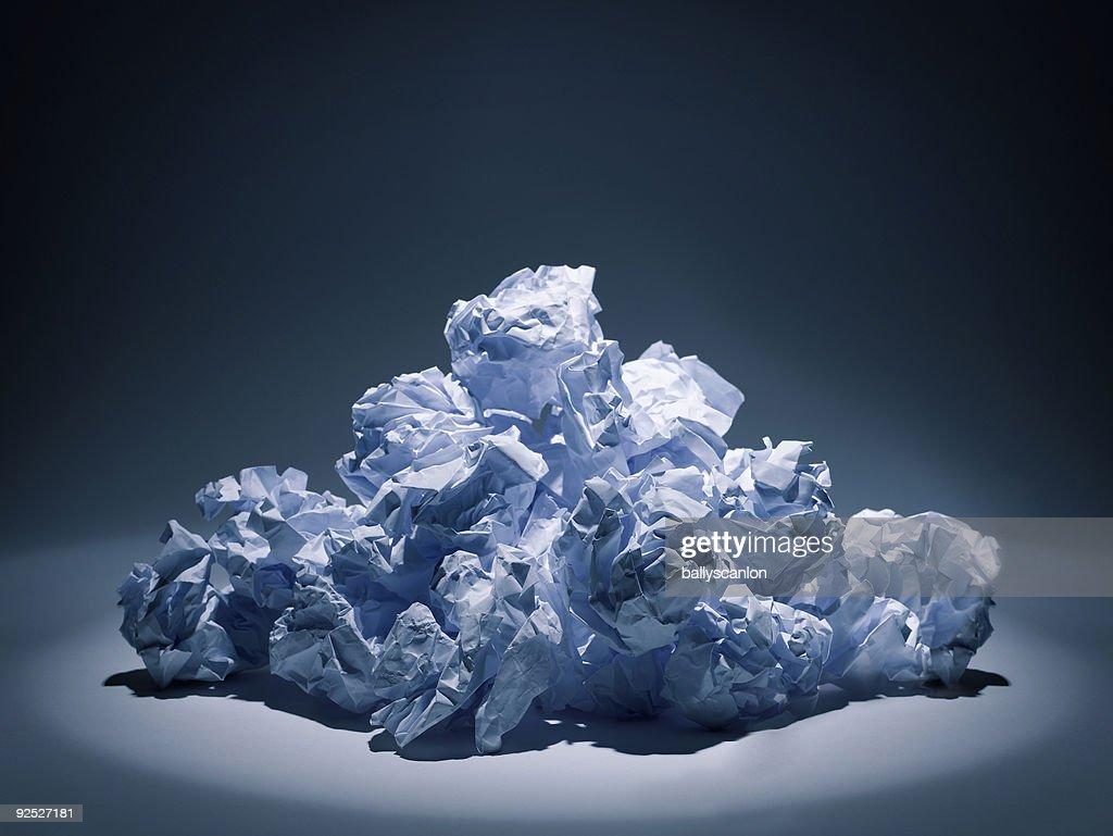 Stack of crumpled white paper balls.