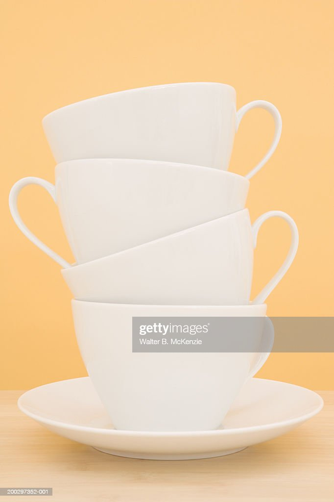 Stack of cups on saucer : Stock Photo