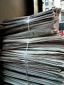 Stack of daily business newspapers.