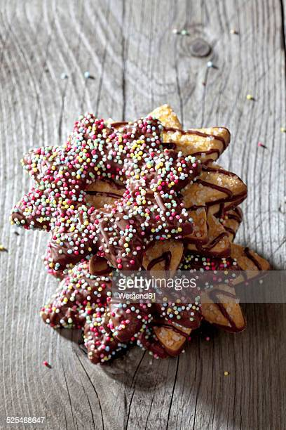 Stack of decorated Christmas cookies on grey wood