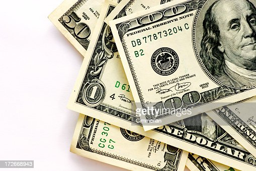 Stack of different denominations of villain a white back